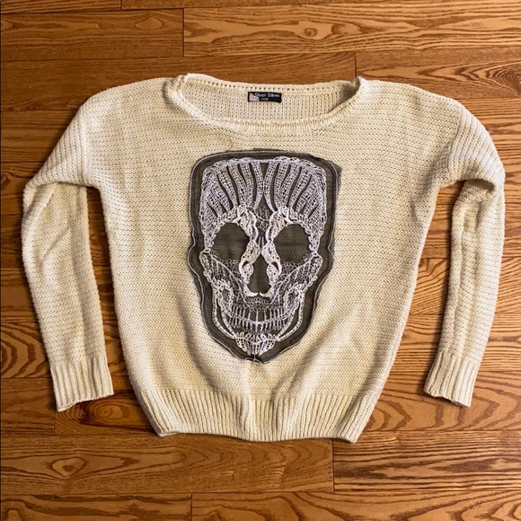 Skull knit sweater size small